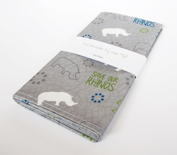 SaveOurRhinos_TeaTowel_Wrapped